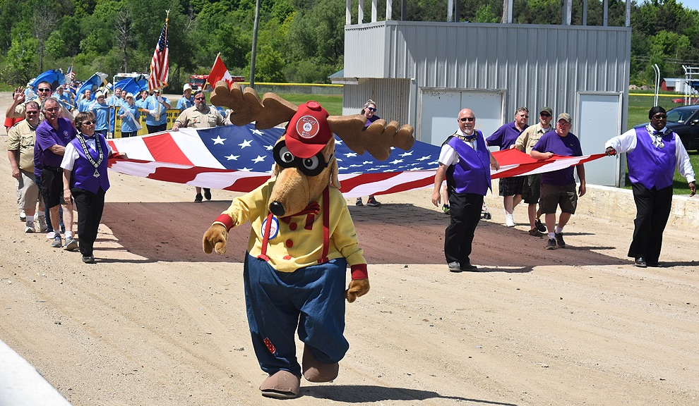 Elroy the Elk, the Gouverneur Elks Lodge No. 2035 mascot, adds in some upbeat fun as he leads the Elks Lodge members and Gouverneur Boy Scout Troop 21 carrying the American Flag. (photo by Jessyca Cardinell)