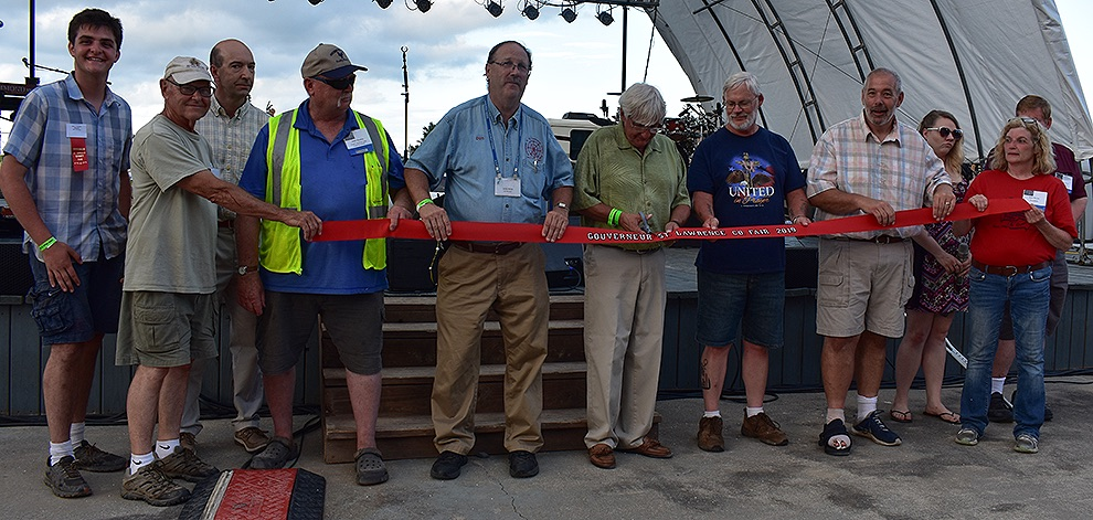 The ribbon-cutting ceremony at the 2019 Gouverneur and St. Lawrence County Fair on Tuesday, July 30. From left: Associate Director Nicholas Whitney, Fair Director and Past President Lyle Hotis, Fair Director John Hunter, Fair Manager Don Peck, Village of Gouverneur Mayor Ron McDougall, Fowler Baptist Church Pastor Howard Maxson, Town of Gouverneur Supervisor Dave Spilman, Jr., Fair President Beth Martin. (Jessyca Cardinell photo)