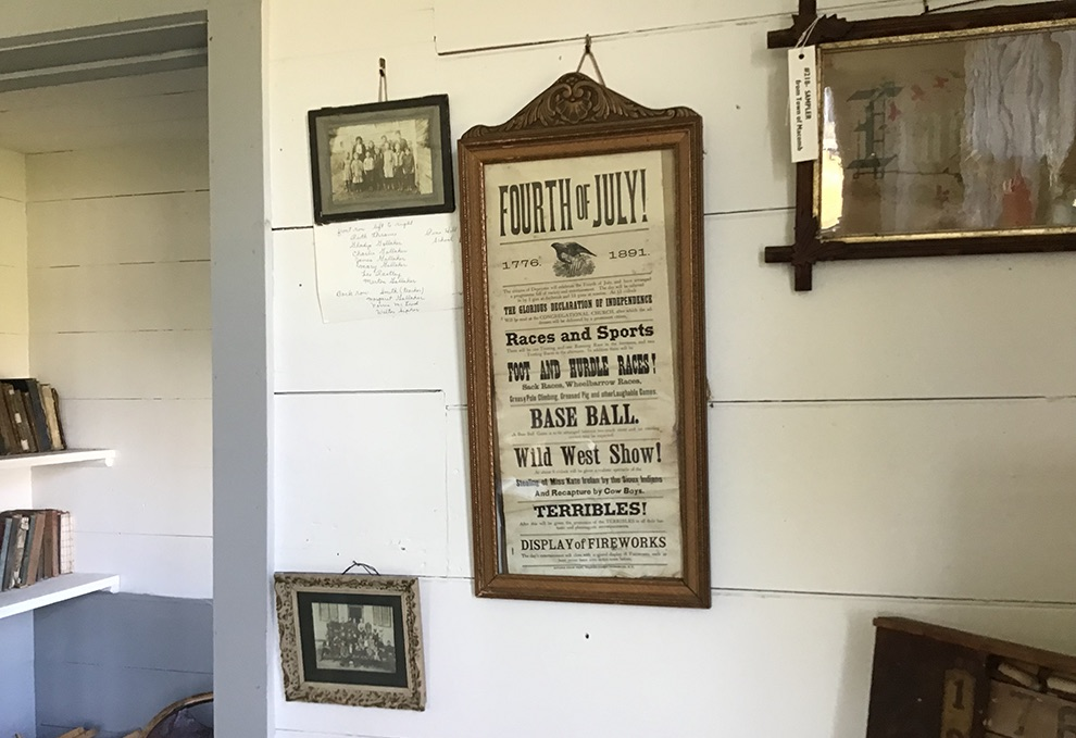 Historical photos and poster hang on the schoolhouse wall. (photo by Rebecca Reynolds)
