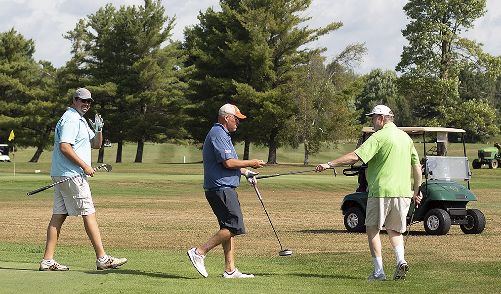 Local golfers participating in the 2019 Ryan's Wish Golf Tournament on Saturday, August 17 give a gentle wave after they successfully sunk their ball in the first hole at Emerald Greens in Gouverneur. (Rachel Hunter photo)