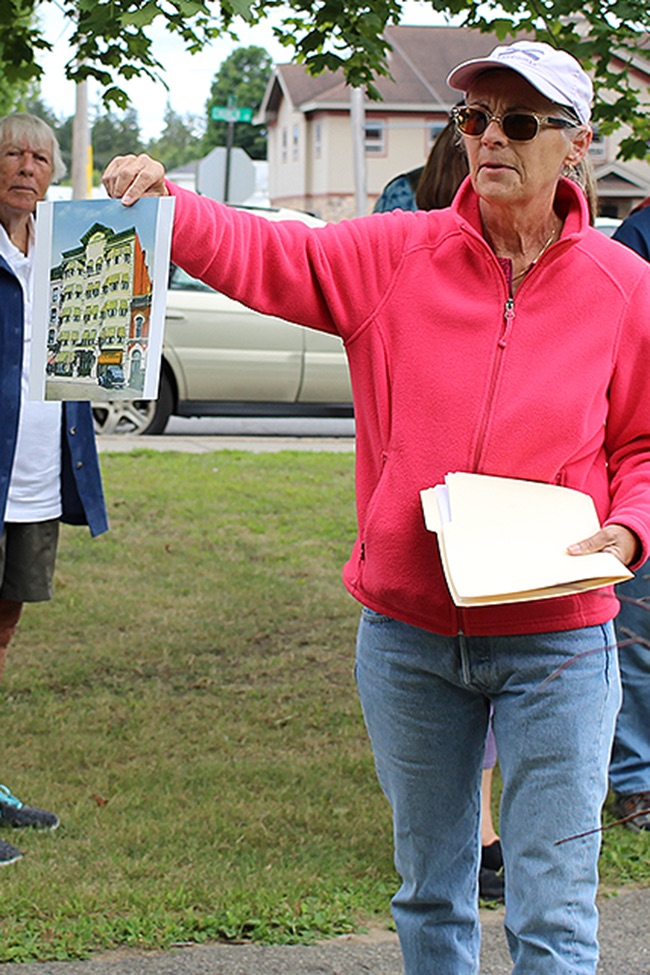 Lea Dickson of Fowler shows off a historic picture of the St. Lawrence Inn. (Rachel Hunter photo)