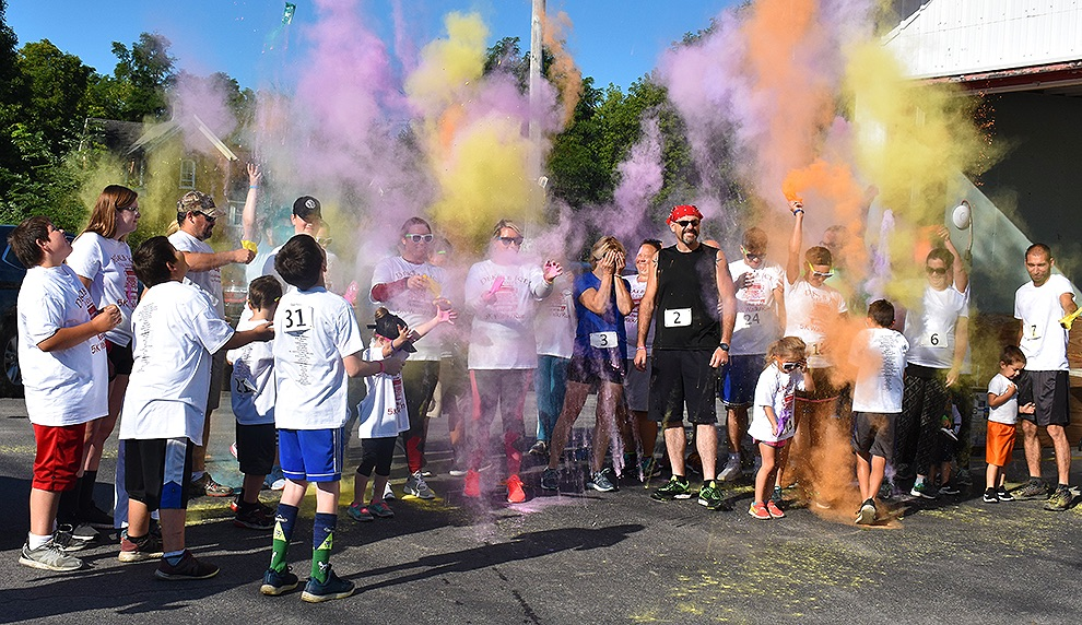 The participants in the Second Annual DeKalb 5K Color Run start the event off with a colorful display. (photo by Jessyca Cardinell)