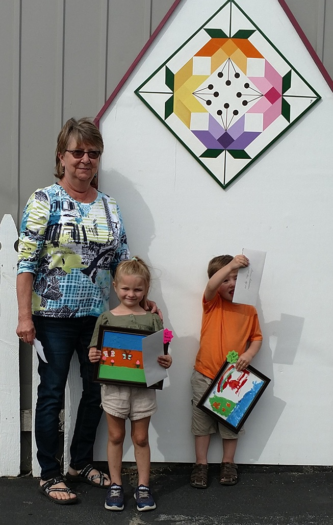 Artsy Contest Judge Donna Thorpe of Fowler with 0-6 age category winners Keelee Bice and Quinn Richardson. (photo provided)