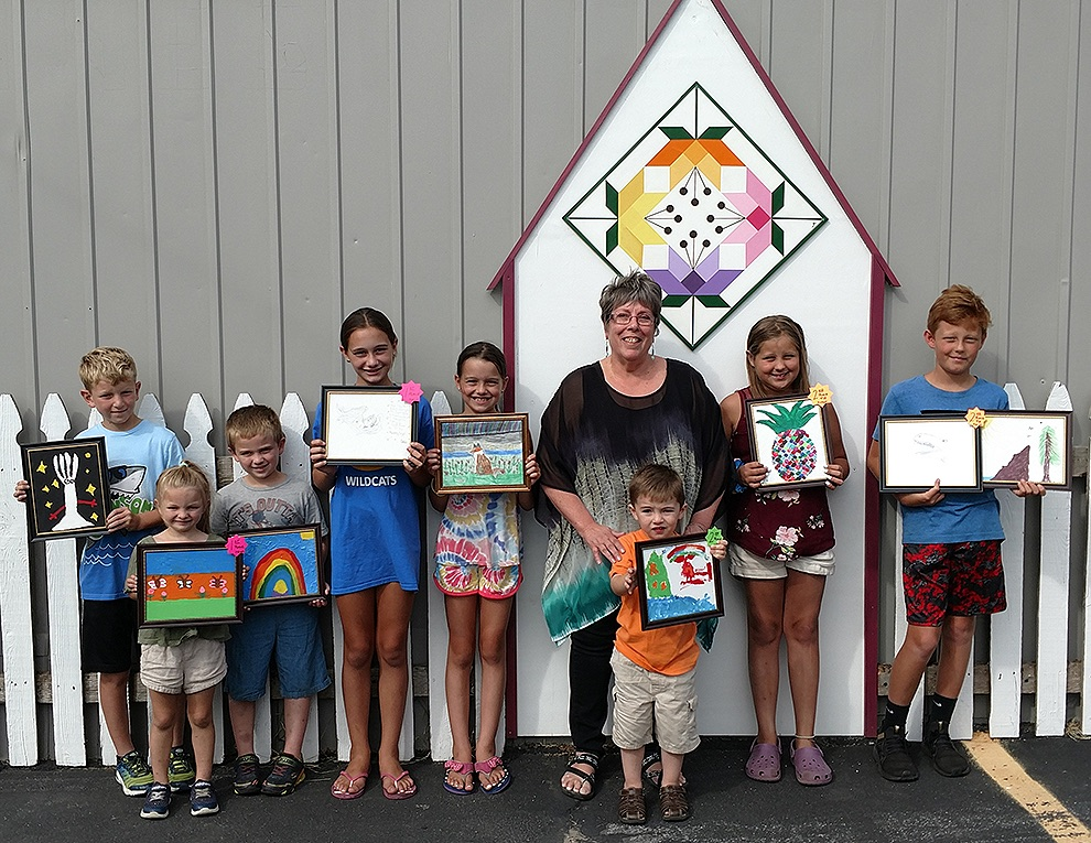 Gari Vibber of North Country CrossRoads with Artsy Contest youth winners Kelvin Bice III, Keelee Bice, Kameran Bice, Mackensie Koerick, Moriah Koerick, Quinn Richardson, Afton Riley, Jack Riley. Missing from photo: Arthur Anson. (photo provided)