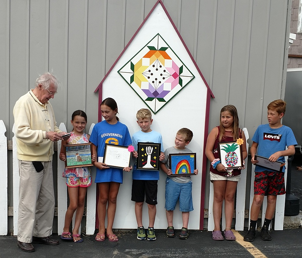 Artsy Contest Judge Curran Wade of Gouverneur with 7-12 age category winners Moriah Koerick, Mackensie Koerick, Kelvin Bice, Kameran Bice, Afton Riley, Jack Riley. (photo provided)