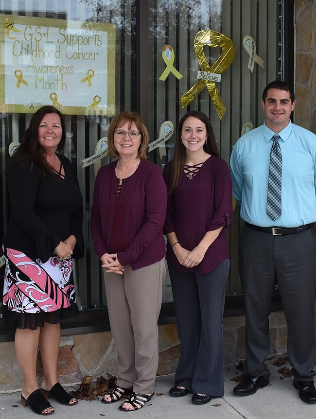 Gouverneur Savings and Loan Association employees show their support for Childhood Cancer Awareness Month. From left: Tracy Stowell, Glenda Bickford, Cheyenne Whitford and Jim Campanaro. (photo by Jessyca Cardinell)