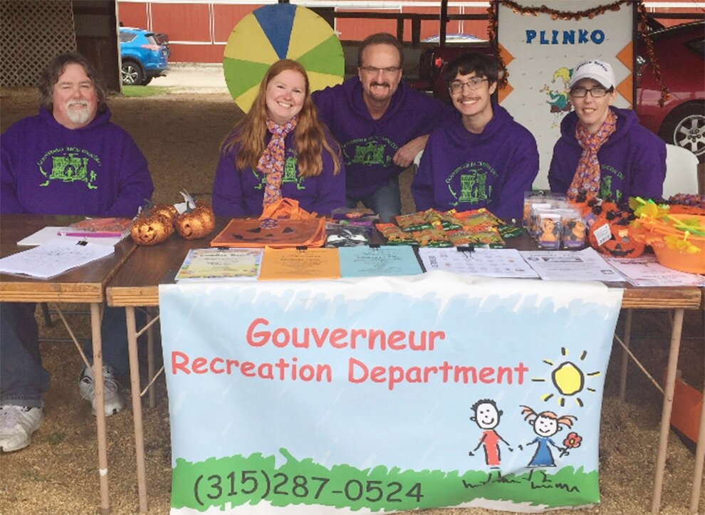 Gouverneur Recreation Director Casey Canell (center) and attendants (from left) Jeff Burt, Kristin Simmons, Connor Canell and Michelle Prashaw offered children's games and activities on Saturday, September 28 at the 2019 Gouverneur Pumpkin Festival. (photo provided)