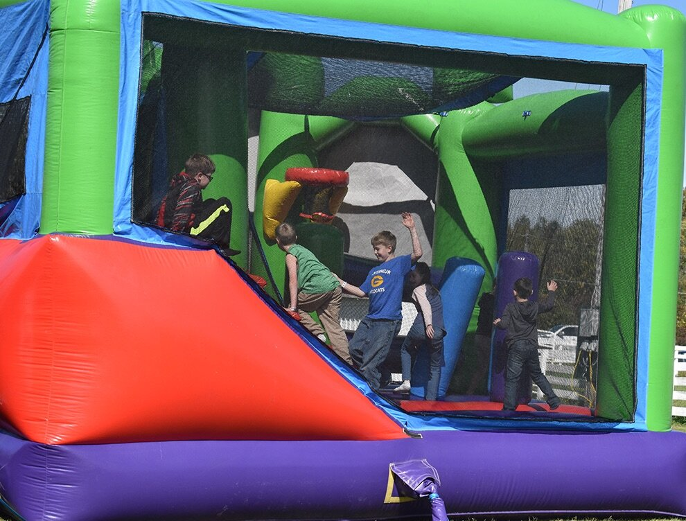 The bounce houses at the 8th Annual Gouverneur Pumpkin Festival brought droves of youngsters in participating in the great fun. (photo by Jessyca Cardinell)