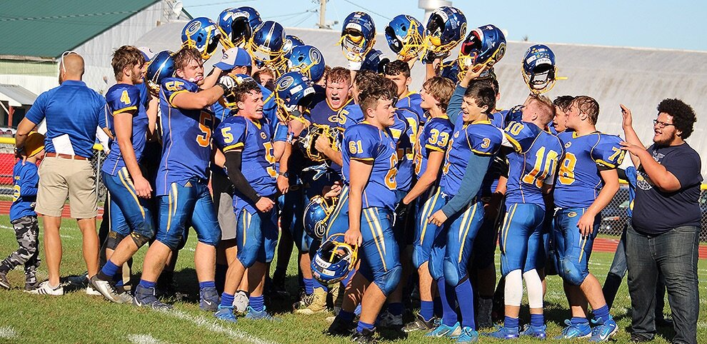 Gouverneur Wildcats coming out of a huddle after their triumphant victory over the Potsdam Sandstoners on Saturday, October 5 on the Frank LaFalce Field. (Rachel Hunter photo)