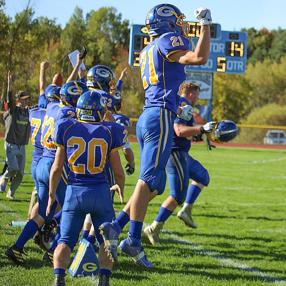 Gouverneur Wildcats on the sidelines celebrate as the scoreboard went from being a 14-14 tie to a Wildcat win (15-14) after Running Back Kyle Savage kicked the extra point in double overtime. (Rachel Hunter photo)