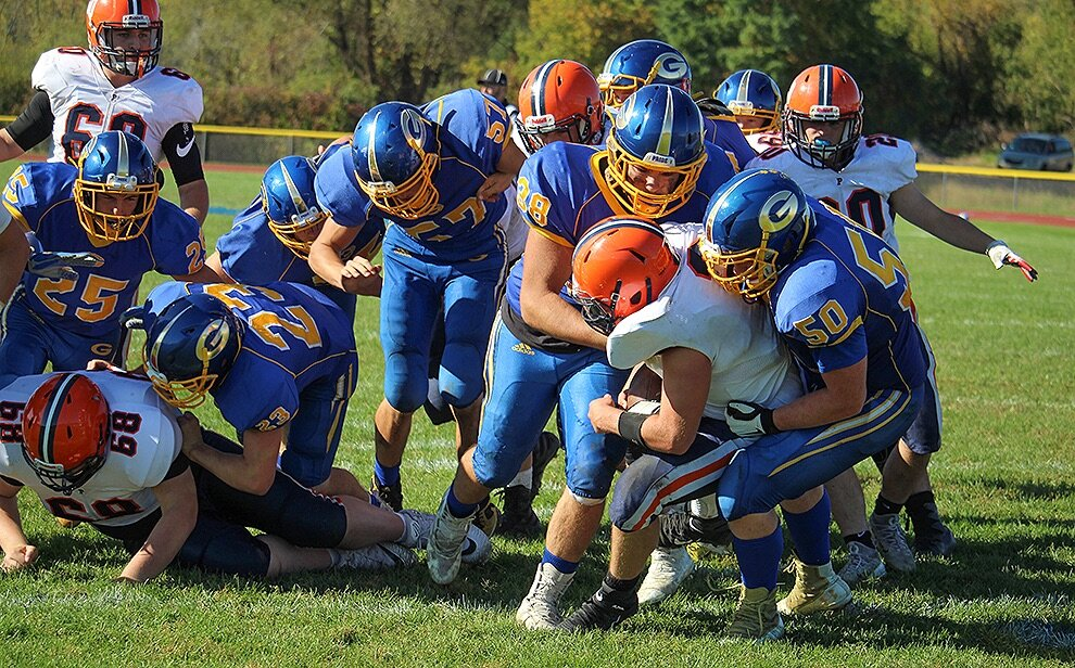 Gouverneur Wildcats TE/LB Matthew Turner (38) and OL/DL Nicholas Embry (50) tackling a Potsdam Sandstoner ballhandler during the Oct. 5 game on the Frank LaFalce Field. (Rachel Hunter photo)