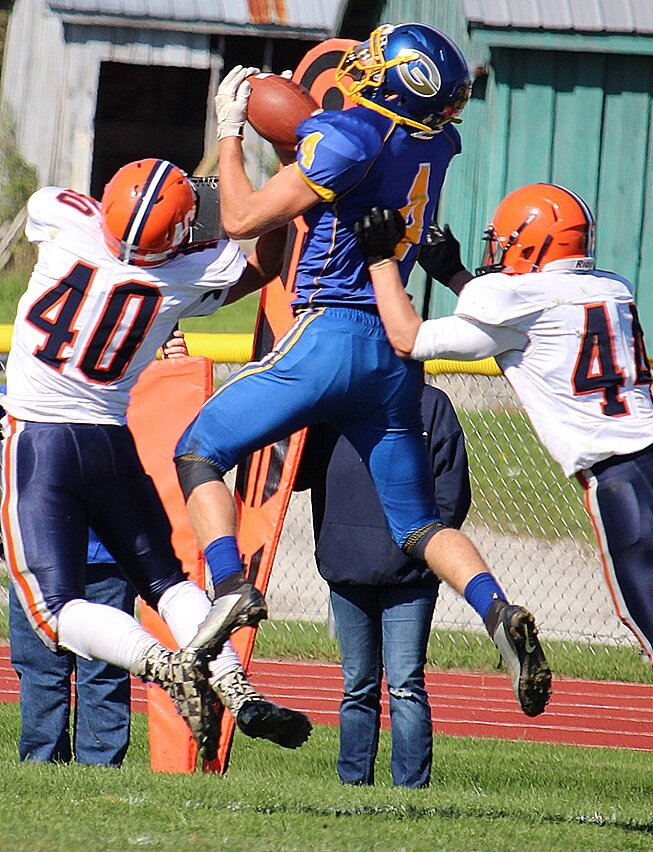 Gouverneur Wildcat Running Back Mitchell Tyler (4) goes up high to take possession of the pigskin during a play on the Frank LaFalce Field last Saturday in the game against the Potsdam Sandstoners. (Rachel Hunter photo)