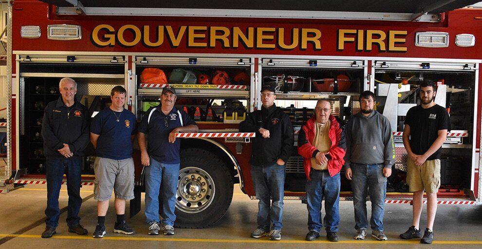 Gouverneur firefighters lined up in front of one of their trucks available for everyone to check out at the annual GFD open house event. From left: Dale Johnson, Dennis Cornelius, Vinny Ferry, Dorwin Gore, Barry Gale, Jordan Ritz and Cody Hadfield. (photo by Jessyca Cardinell)