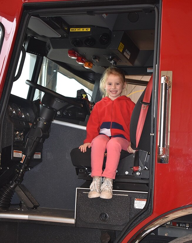 London Wood, 5, is all smiles of excitement as she gets to take a look around inside one of Gouverneur Fire Department's fire trucks with her family at the annual GFD Open House. (photo by Jessyca Cardinell)