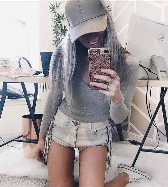 Lindsay from our store Grey Clothing looking so cute with her bodysuit, ball cap, shorts and white Chucks.