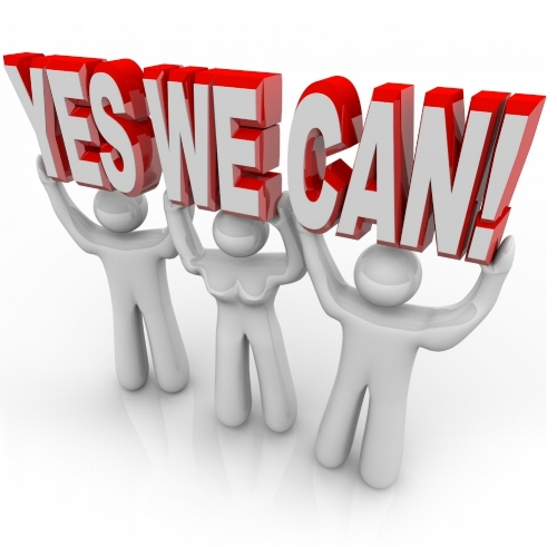 9897430 - a team of people work together to lift the words yes we can to affirm that by cooperating on a challenge, they can reach success and meet their goals