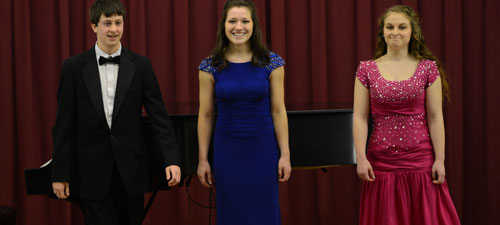 All three ALO students take a bow after their performance at Coker College