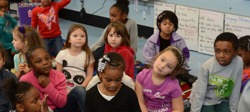 Mrs. Brody's kindergarten class sang a song about hydration for Dr. Comer
