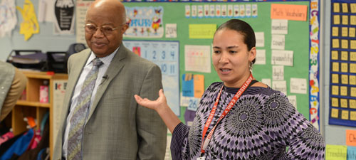 Dr. Comer speaks with a teacher at Southside
