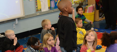 A student in Nancy Williamson's class at Southside tells Dr. Comer about his job