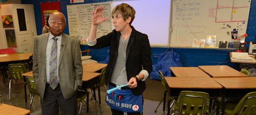 Dr. Comer talks with West Hartsville science teacher Ms Adams