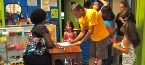 Families sign in for the PULSE end of year mentor-mentee celebration