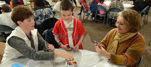 Playing cards at the mentor meet and greet, Jan 2014