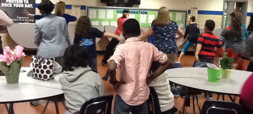 Parents, students and WHE staff practice Zumba at the Jan 2014 PTO meeting