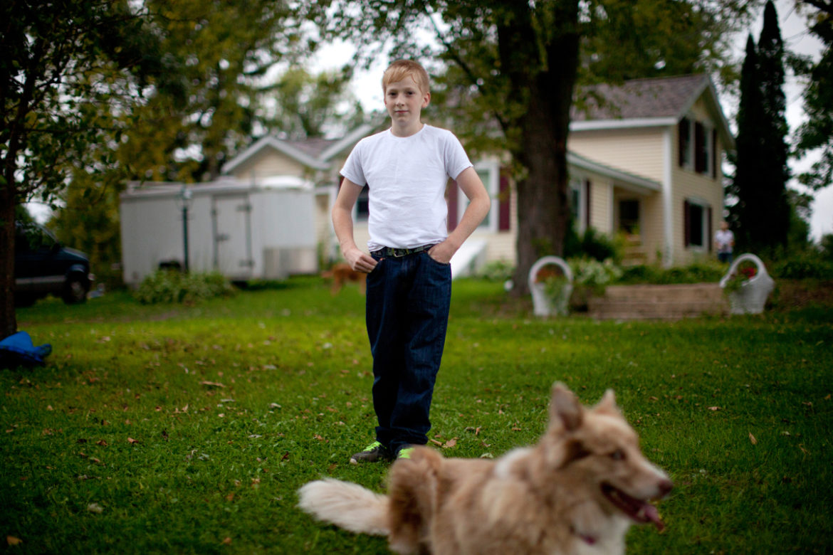 """Jacob Reeves, pictured at home in Stoughton, was diagnosed in 2014 with juvenile dermatomyositis — a rare disease that his mother Dawn attributes to the high level of atrazine found in their well water. """"I only cried once,"""" Dawn Reeves said, """"when they said he might not walk again."""" Coburn Dukehart/WCIJ"""