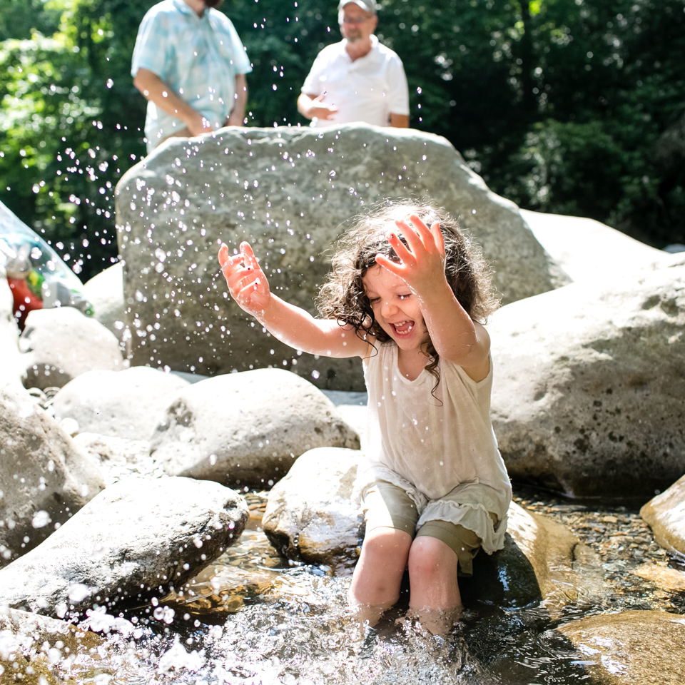 Little_Girl_Playing_In_Mountain_Stream