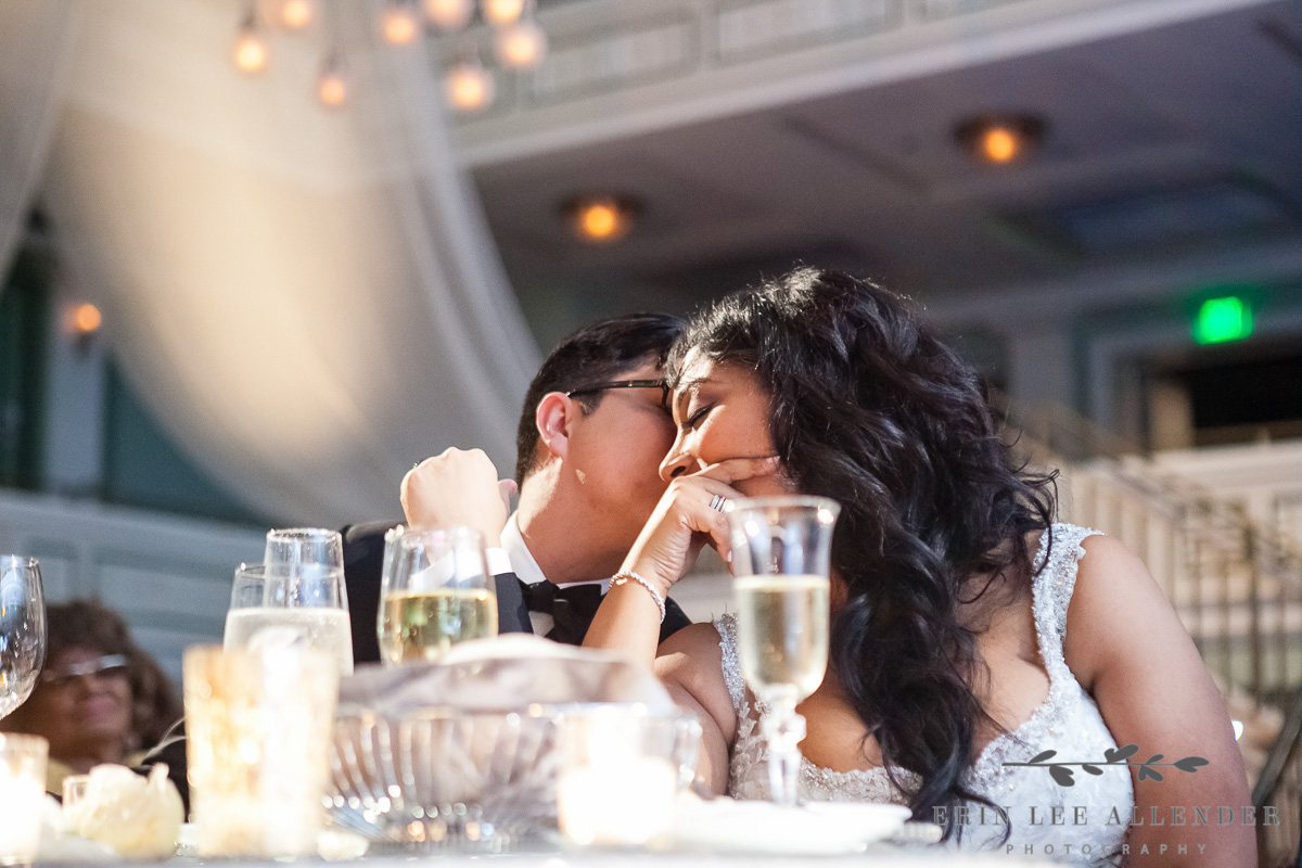 Groom_Kisses_Bride_During_Toast