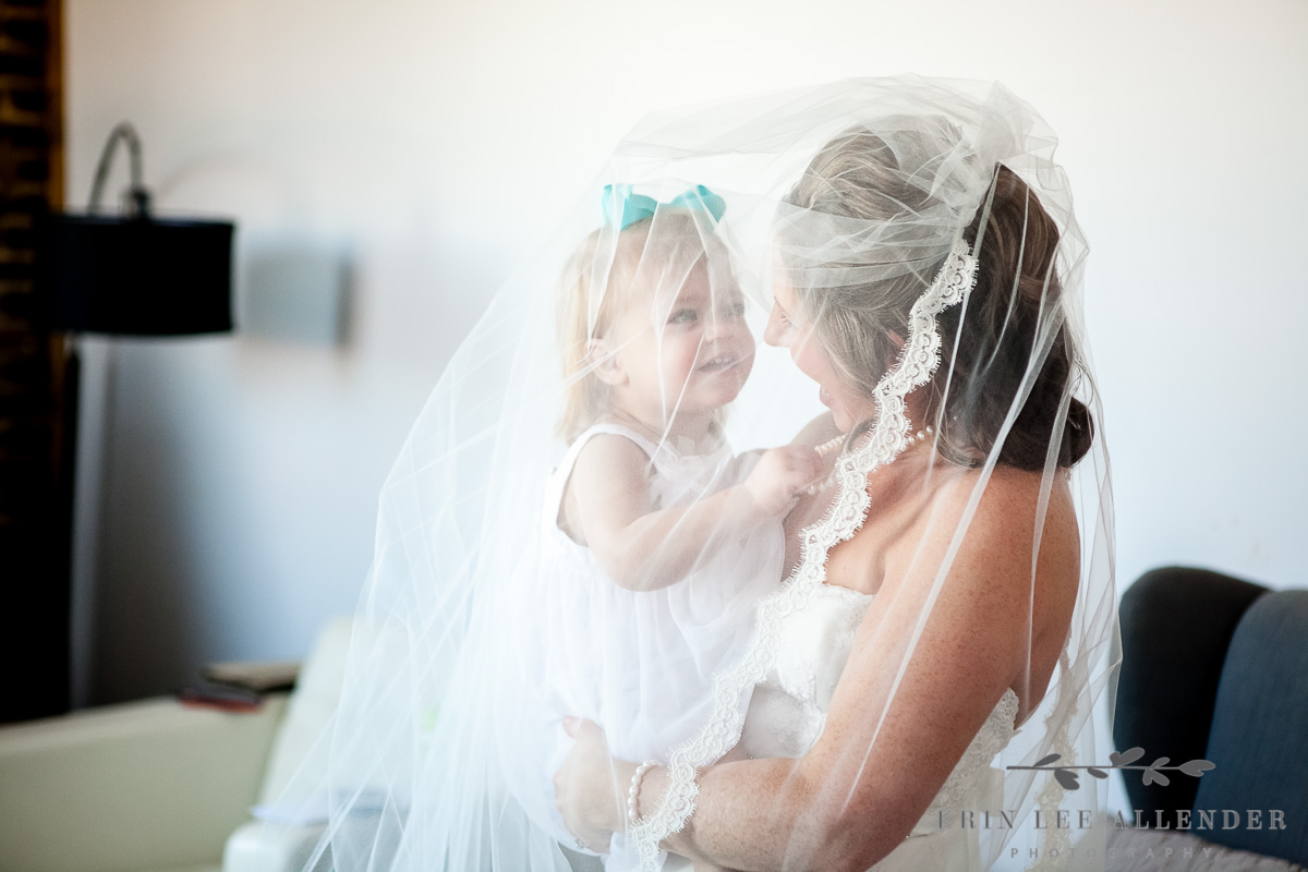 Flower_Girl_Plays_With_Brides_Veil
