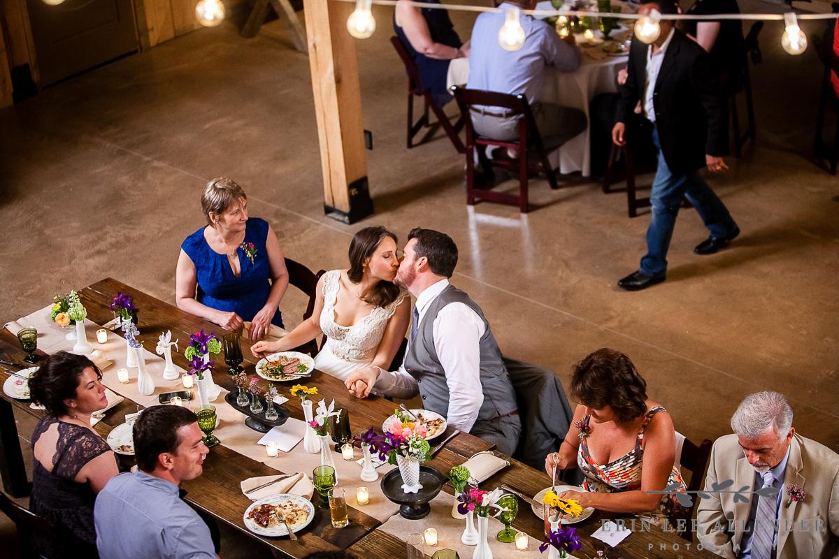 Bride_Groom_Kiss_Head_Table