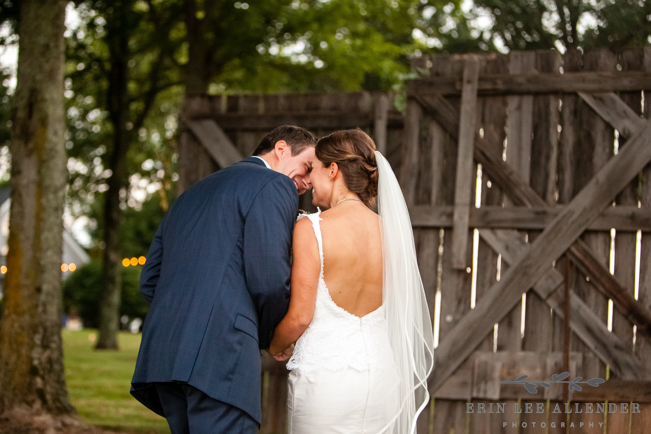 Groom_Bride_Kiss_While_Walking_Down_Aisle