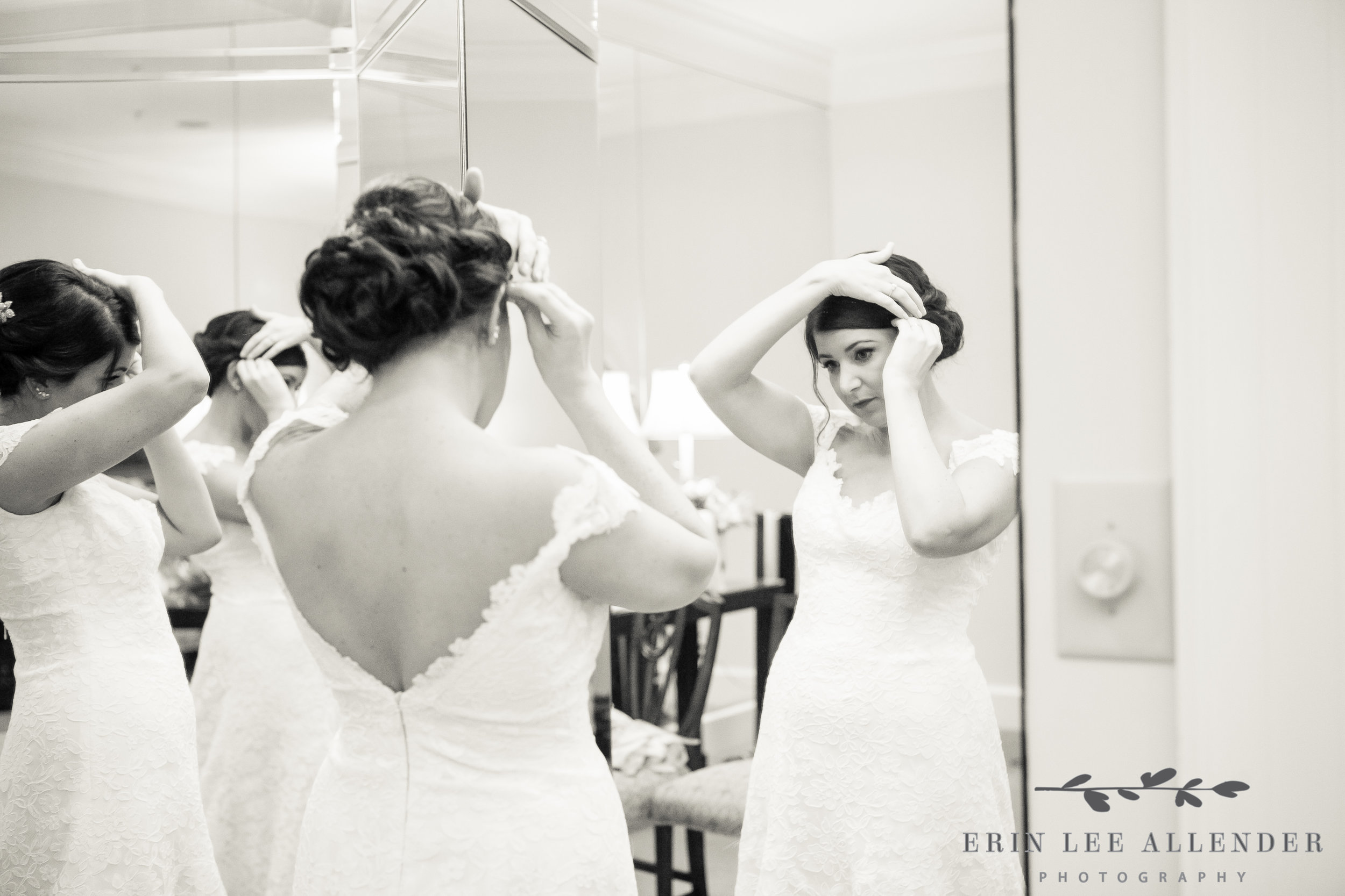Bride_Fixing_Her_Hair_In_Mirror