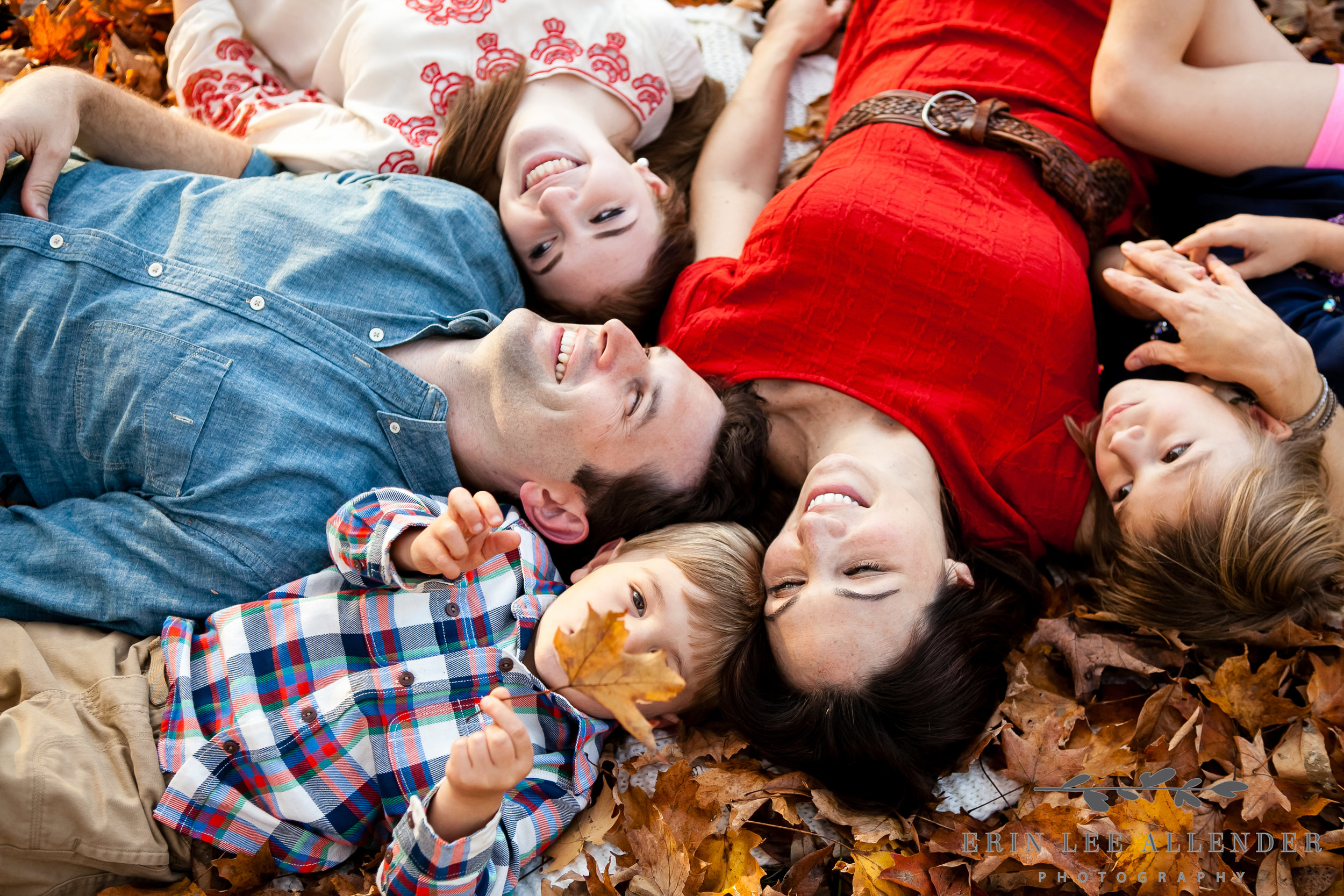 Family_Laying_In_Leaves