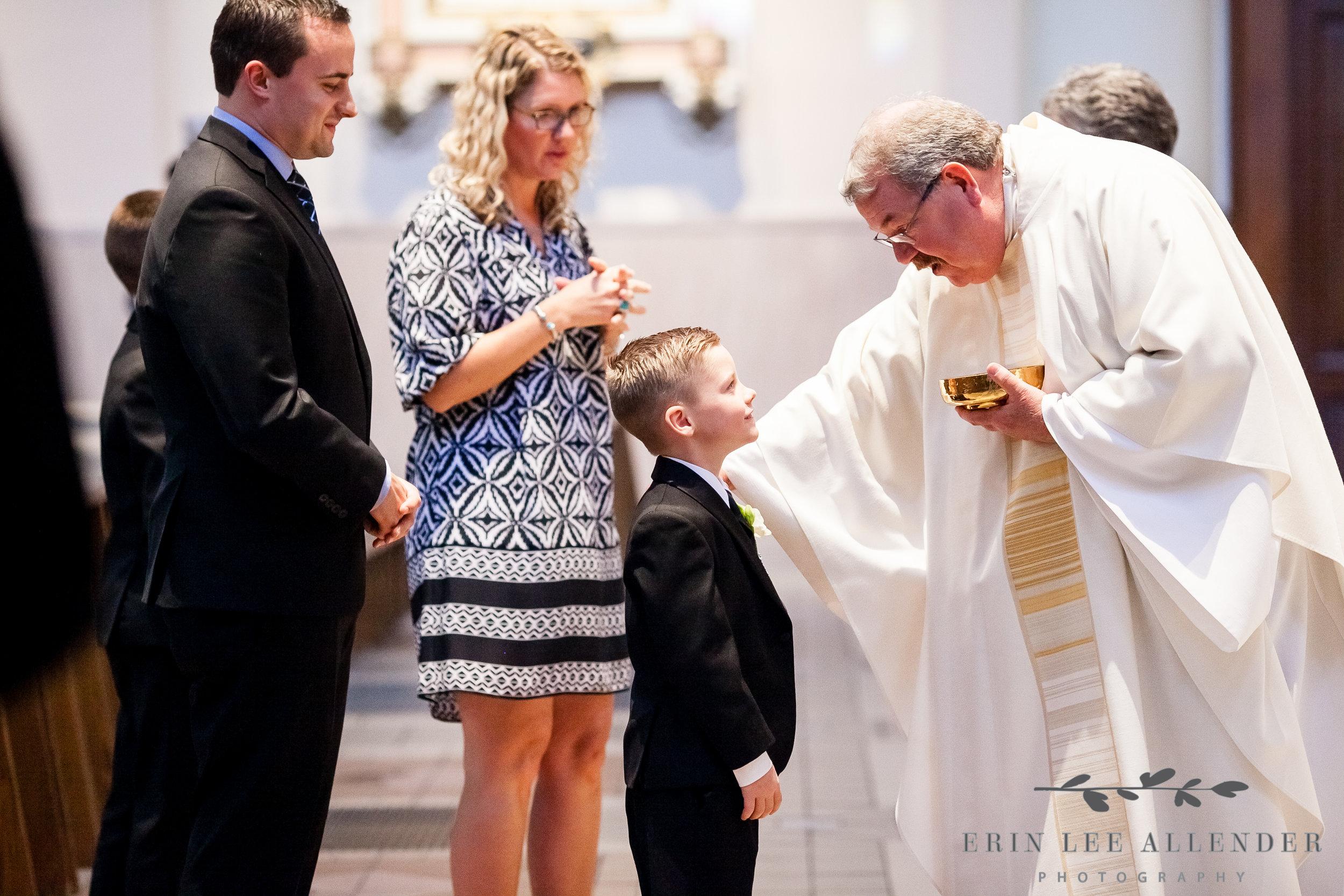 Priest_Blesses Child