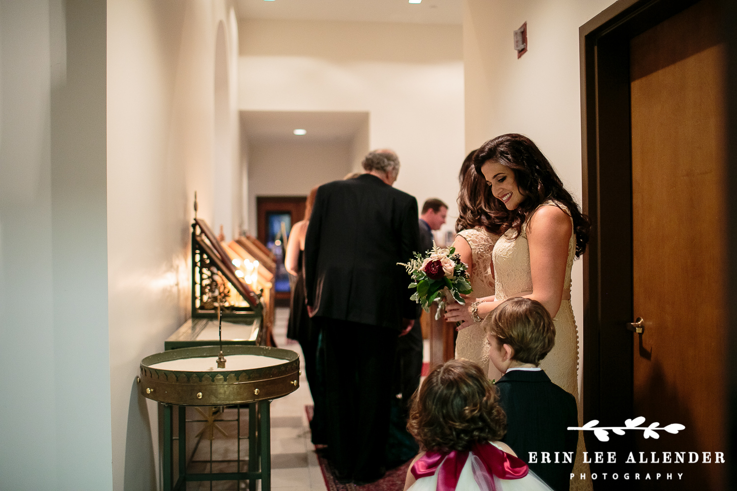 Maid_Of_Honor_Looks_at_Ring_Bearer