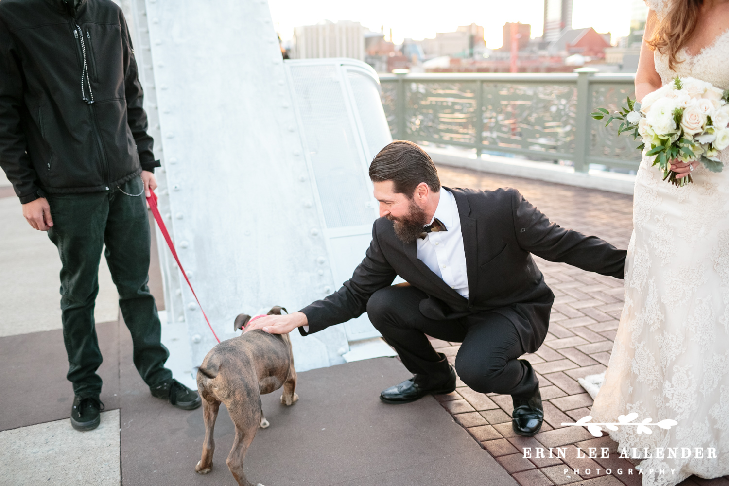 Groom_Pets_Dog_On_Bridge