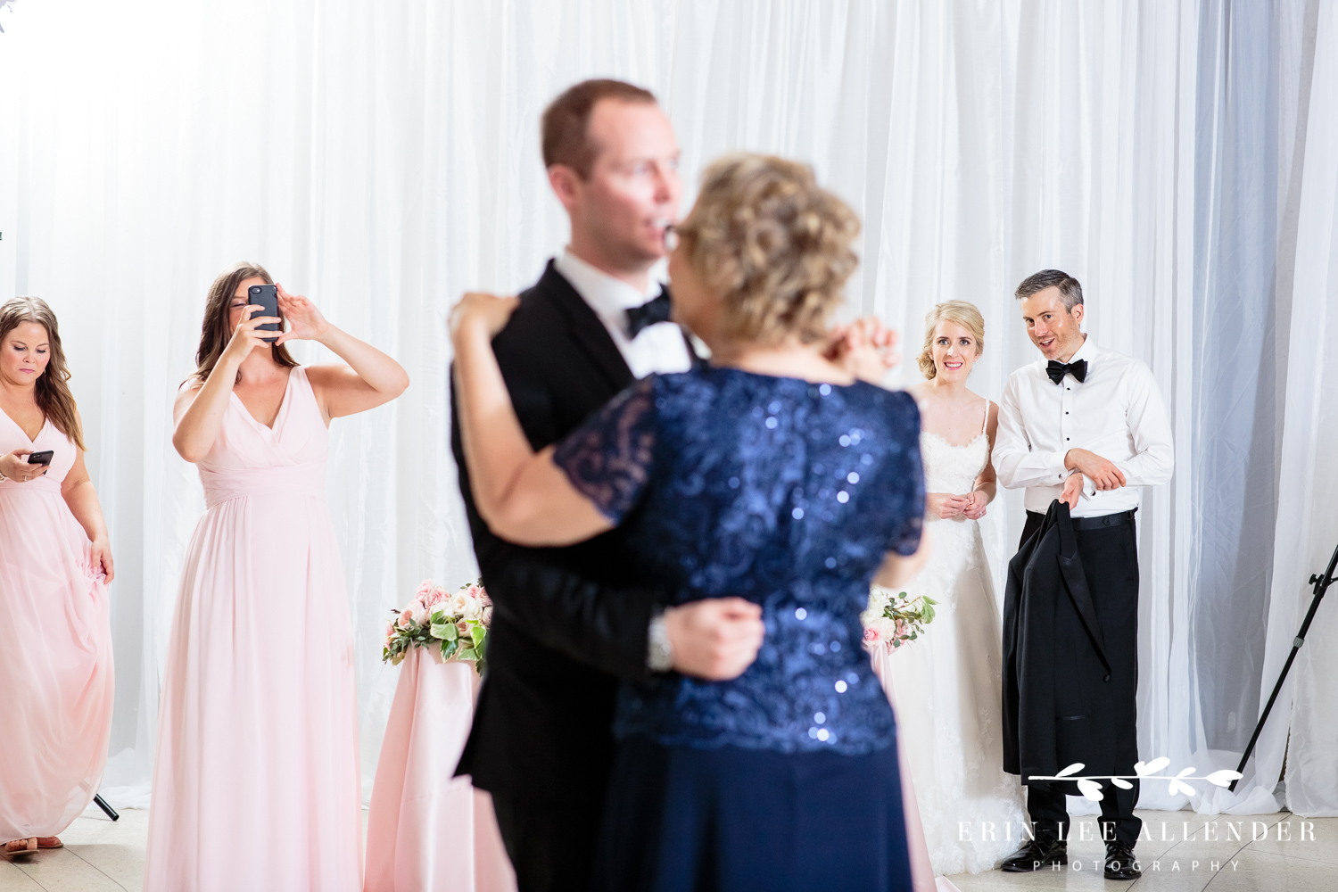 Bride_Watches_Groom_Dance_With_Mom