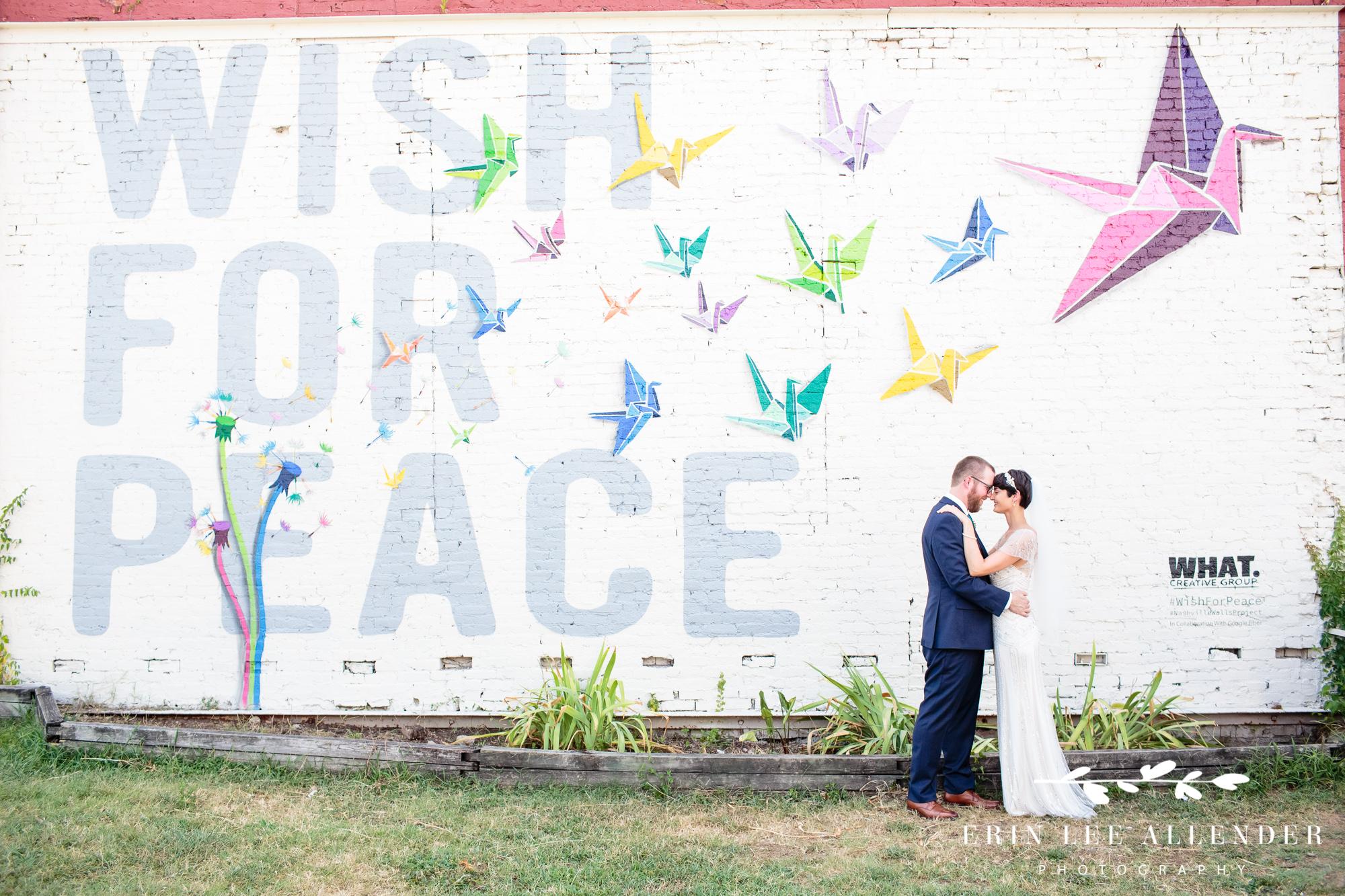 Bride_Groom_In_Front_Of_Mural