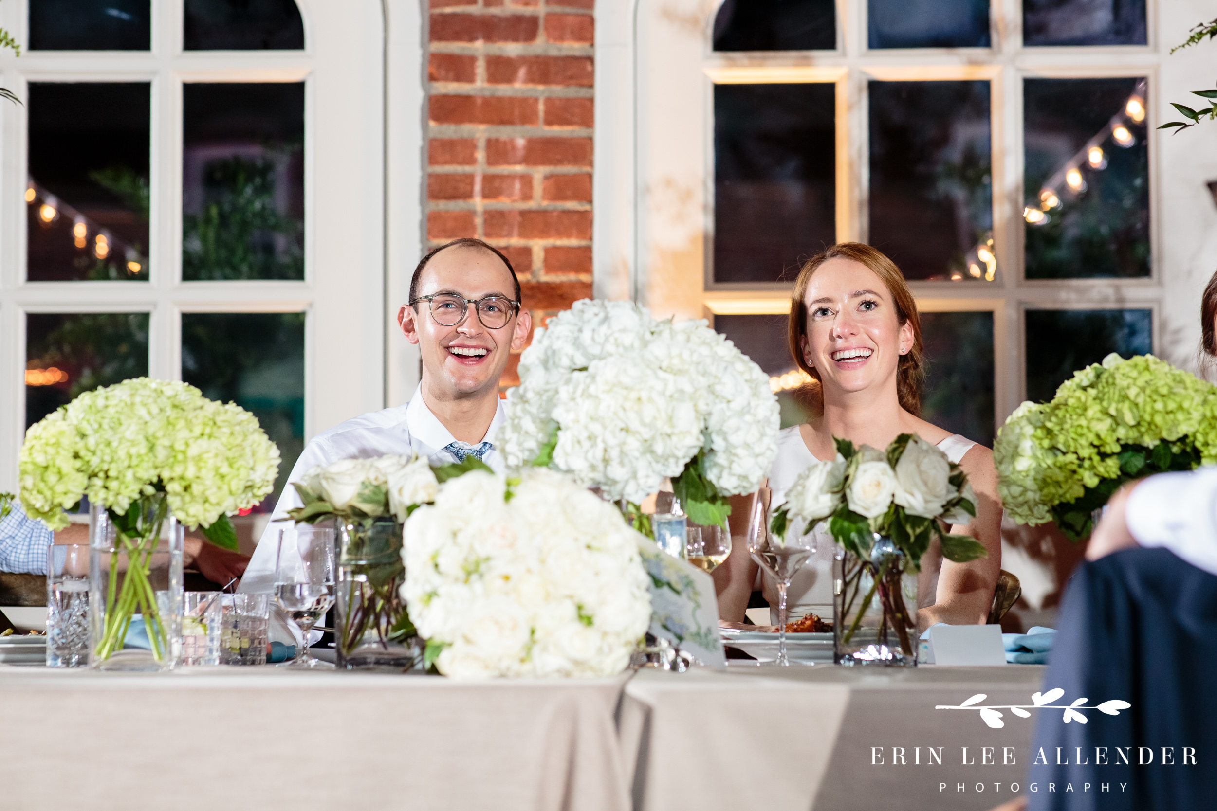 Bride-groom-laughs-toasts