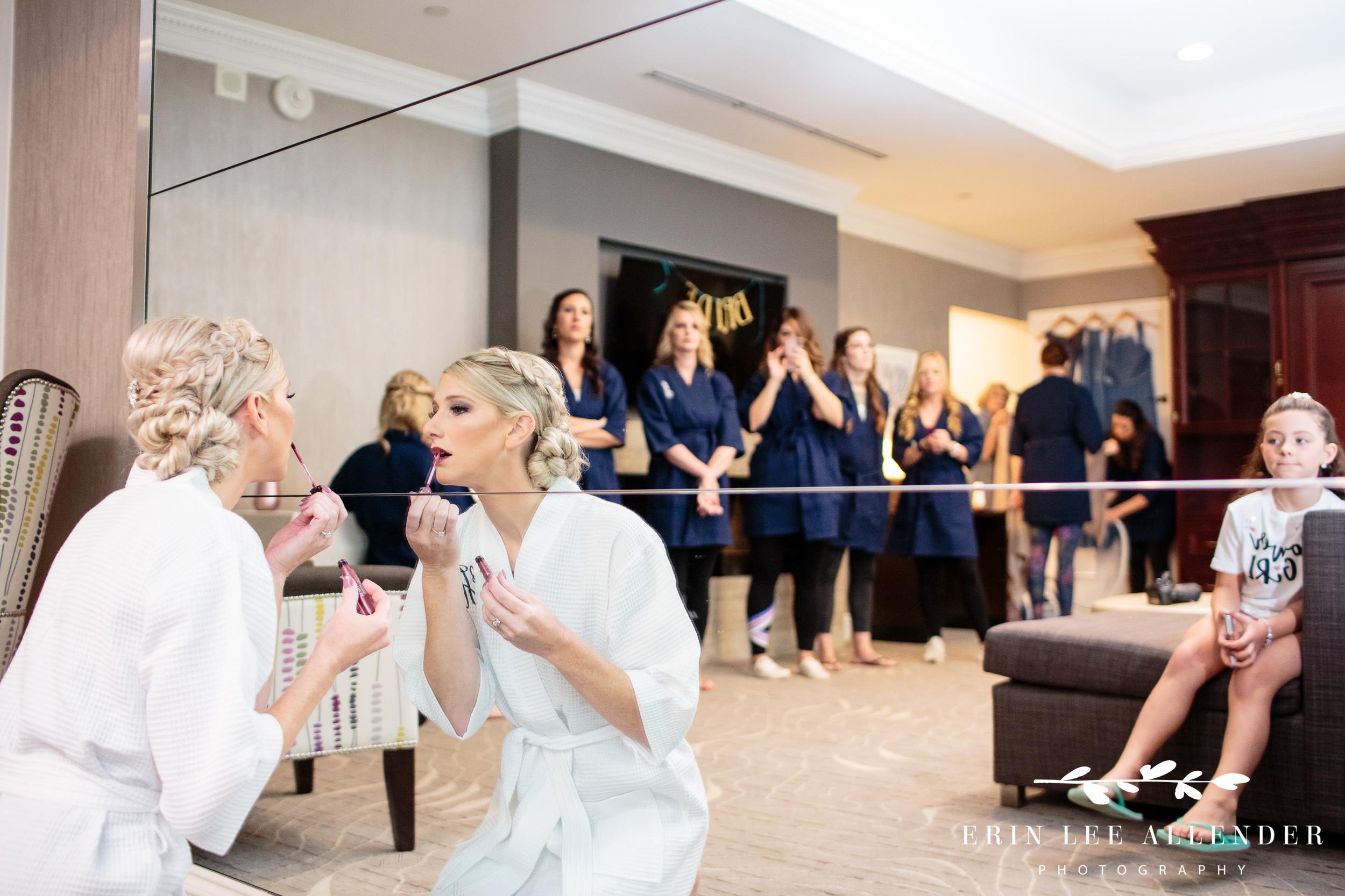 Bride-putting-on-lipstick