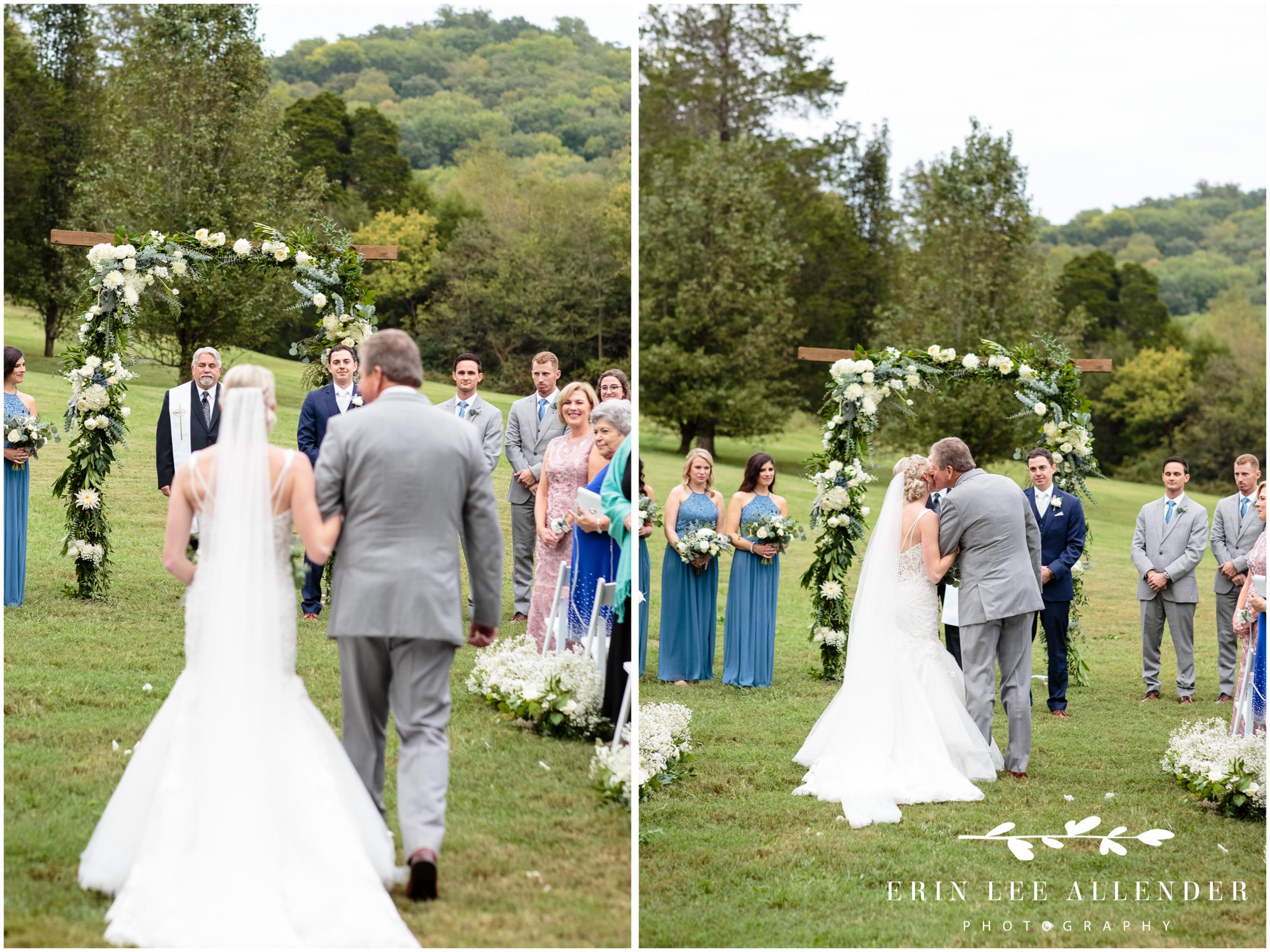 groom-sees-bride-walking-down-aisle