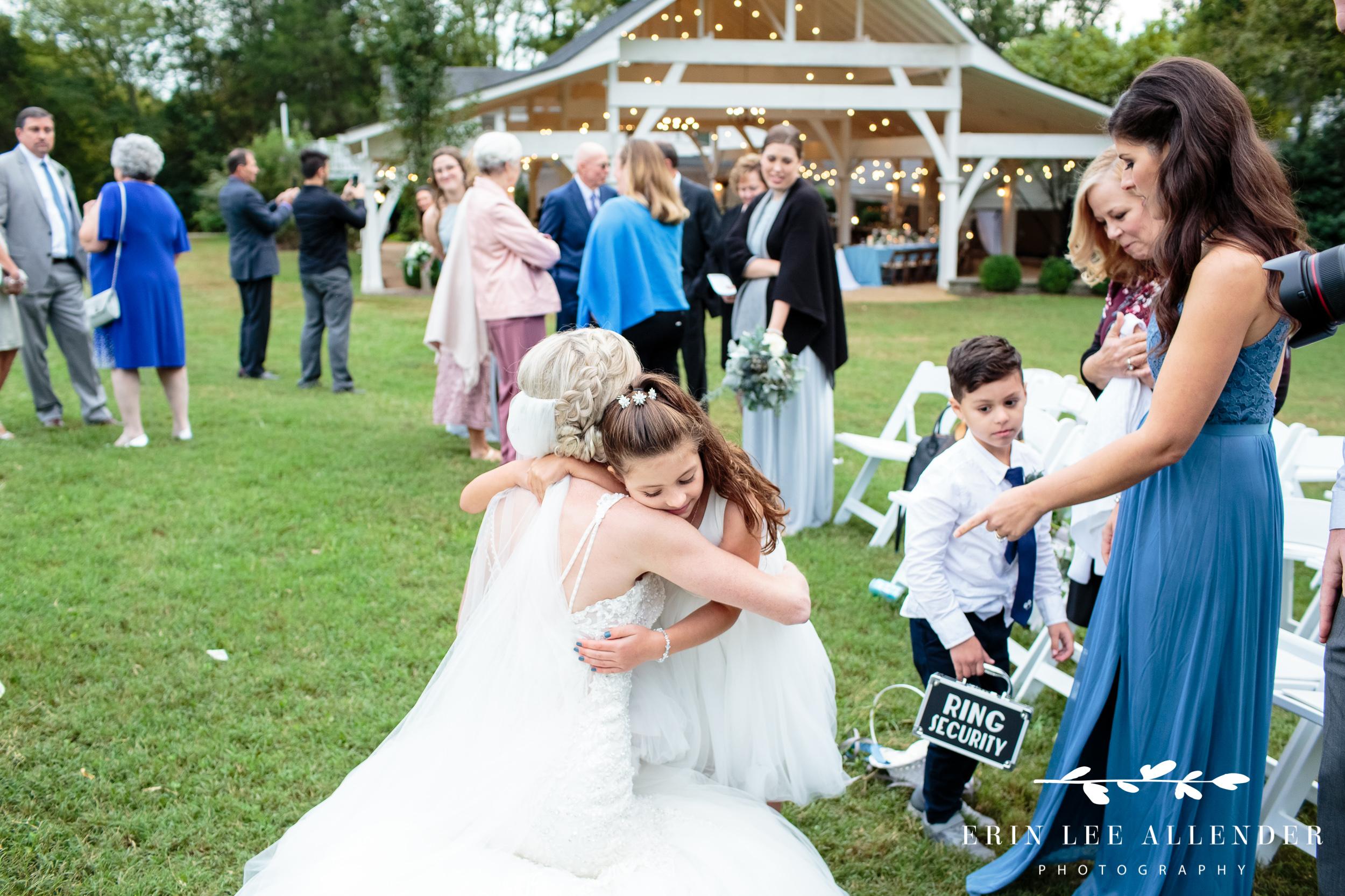 bride-hugs-flower-girl
