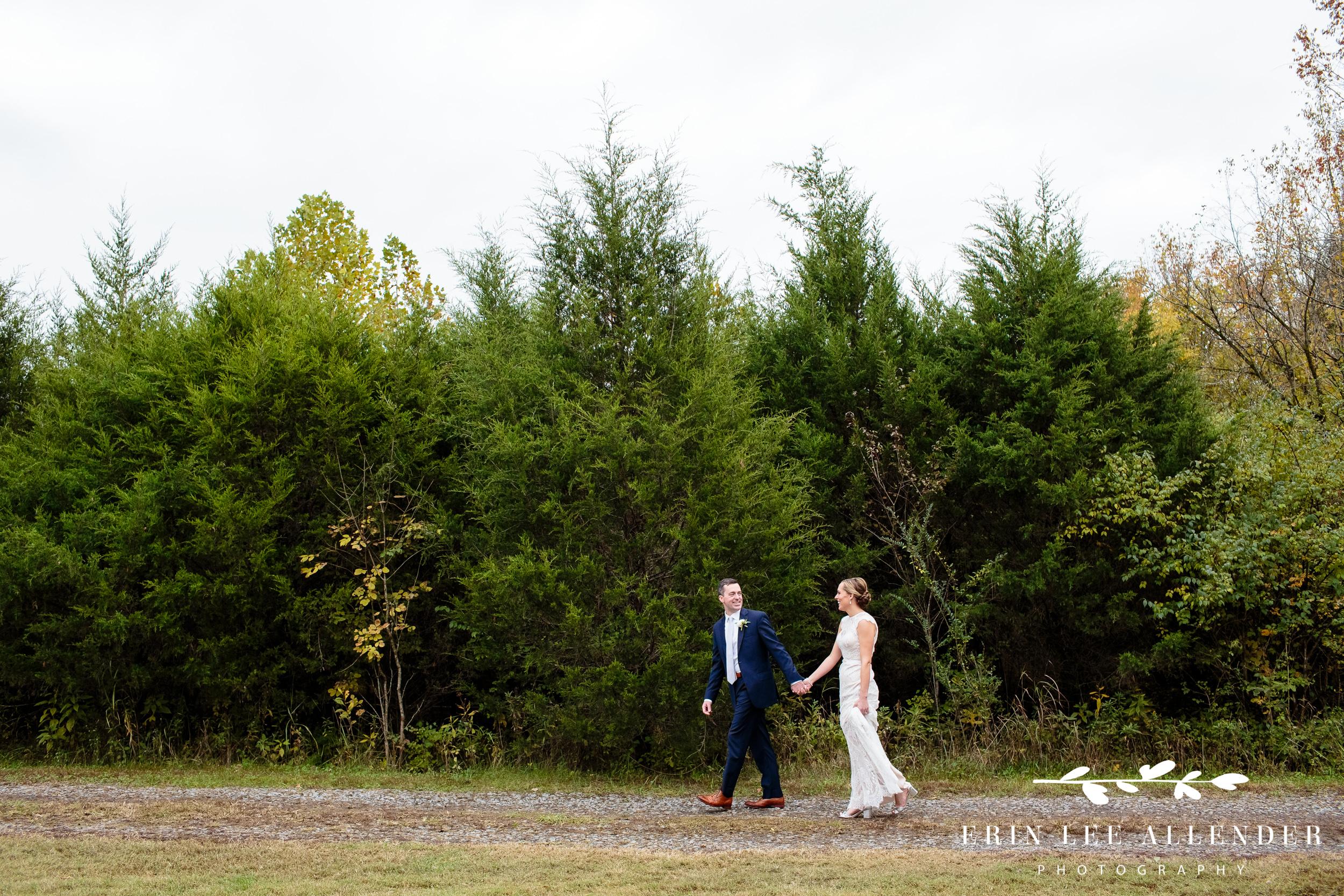 Couple-walking-pine-trees