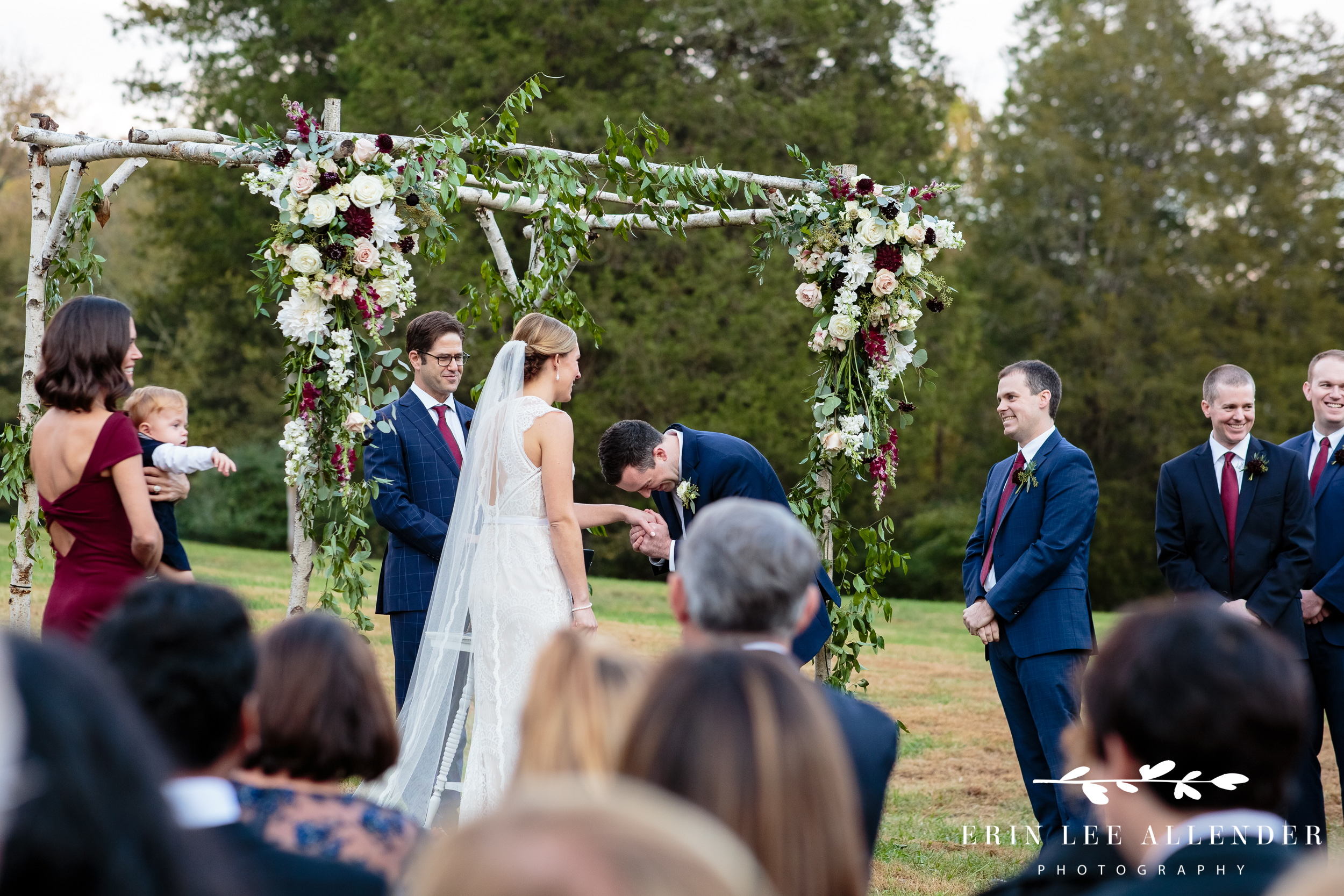 Groom-laughs-during-vows