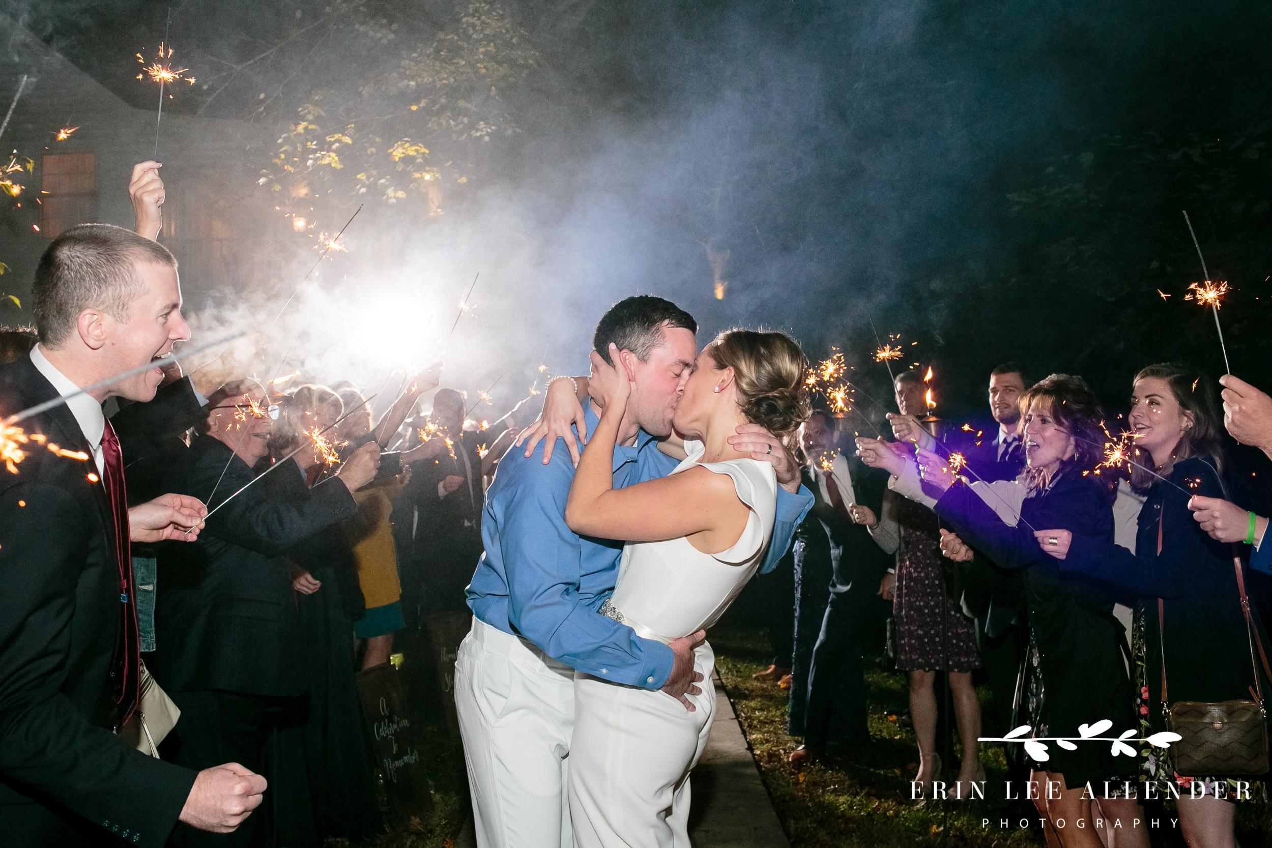 couple-kisses-sparkler-exit