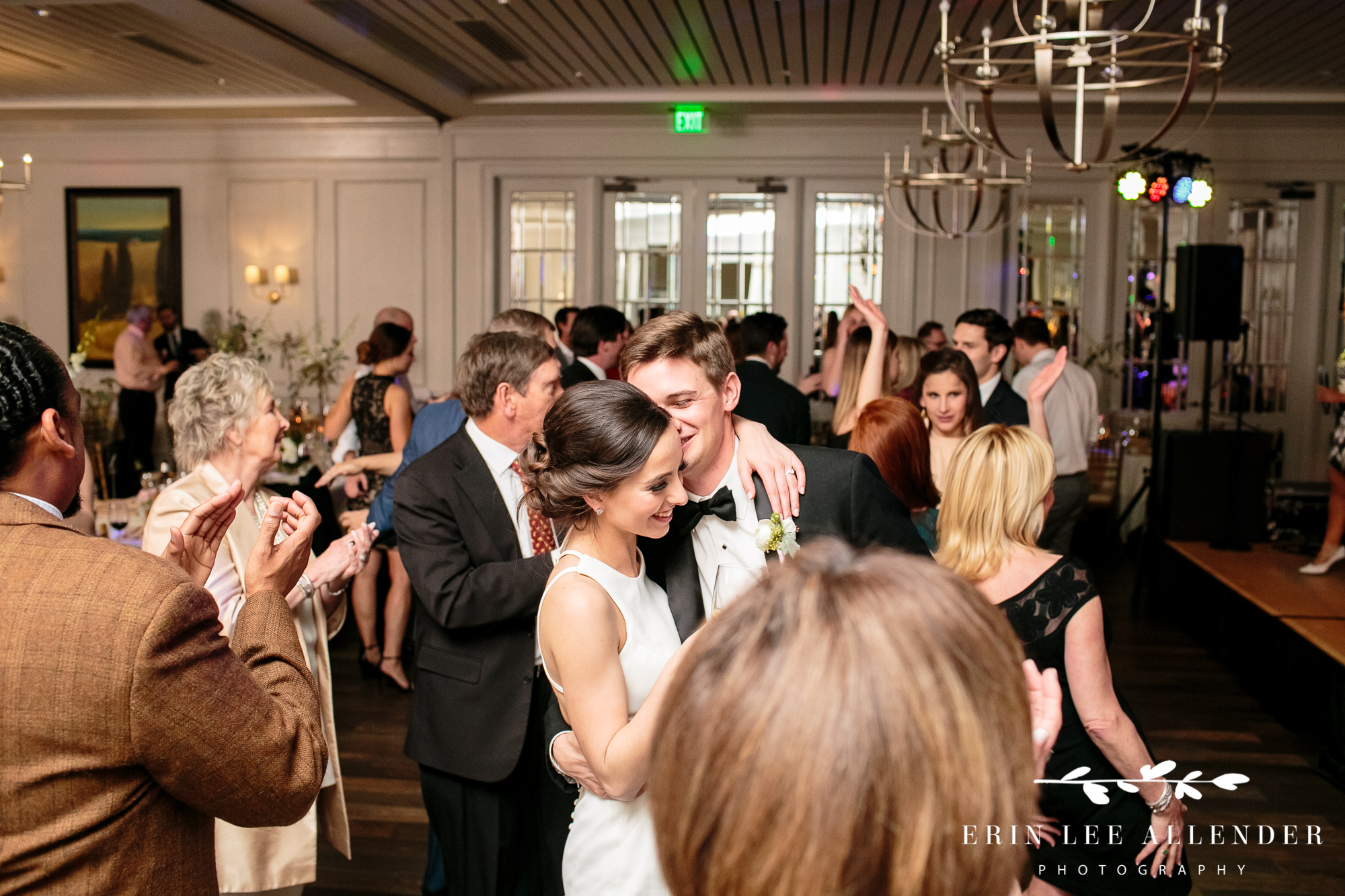 groom-kisses-bride-on-dance-floor