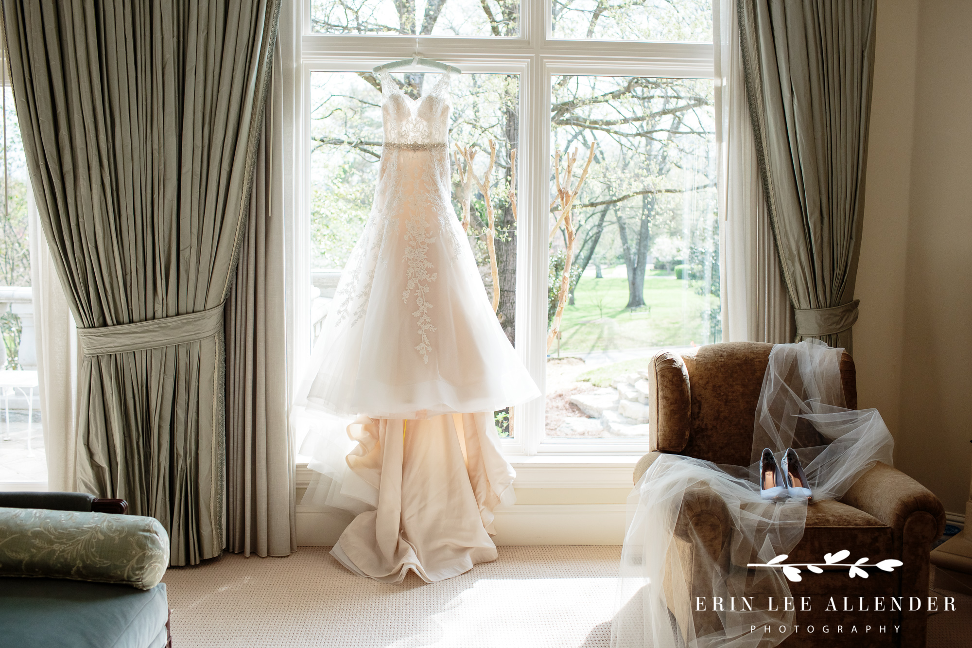Wedding-gown-hanging-in-window